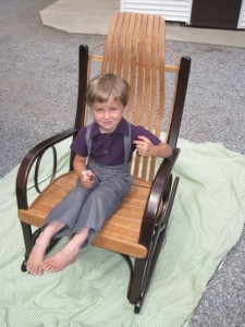 Firman tries my rocker on for size. His daddy Marty made the rocker.